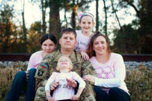 Sgt. 1st Class Forrest W. Robertson, 35, of Westmoreland, Kan., died Nov. 3, in Pul-E-Alam, Afghanistan. Pictured here with his wife and children in Kansas (courtesy Facebook).
