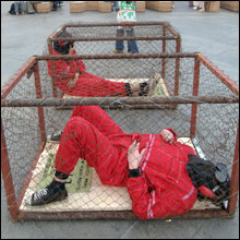 Guantanamo Bay prison camp had prisoners in cages like dogs.