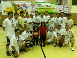 Rawabi Electric team receives championship trophy from commissioners Jun Sanchez and Edwin Caliboso
