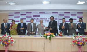 Shri P.Jayarama Bhat, Managing Director & CEO of the Bank exchanging the MOU with Shri Avijit Nanda, CEO, TimesofMoney is seen with Shri P. Jairama Hande, Shri N.Upendra Prabhu, Shri M. S. Mahabaleshwara Bhat, Dr. Meera Aranha, General Managers of the Bank and Shri Kunnal Sharma, Aloke Panikar from TimesofMoney.