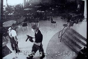Cold Blooded Killers: Columbine high school massacre shooters Eric Harris (left) and Dylan Klebold appear on a surveillance tape in the cafeteria at Columbine High School after killing dozens of students.