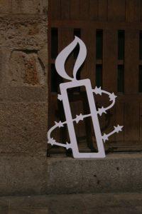 512px-Amnesty_International_(logo)