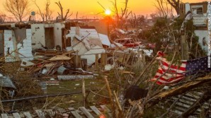 """The reality is this: stronger, more destructive storms are pounding our region with distressing regularity and with huge costs to our State, our residents, and our economy"", said rep. Quigley. Pictured here: Washington , Illinois sits in ruins after a tornado tore through the region on November 18, 2013"