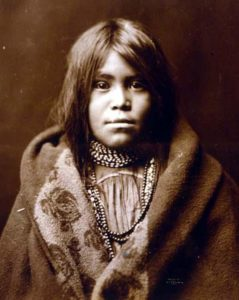 An Apache Indian girl.  It was taken in 1903 by Edward S. Curtis.