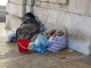 Homeless elderly bag lady sleeps on the street and nobody gives a damn!