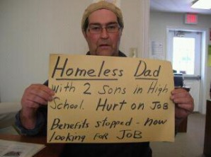 Homeless dad begs for works in 2013.