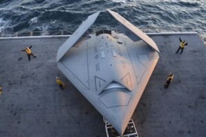 """These cuts threaten the Navy's readiness"""", warned Seantor Hirono of Hawaii. Pictured here:  Image provided by the US navy shows sailors moving a $813 million dollar X-47B Unmanned Combat Air System (UCAS) demonstrator onto an aircraft elevator aboard the aircraft carrier USS George H.W. Bush Tuesday, May 14, 2013. The drone was launched off the George H.W. Bush to be the first aircraft carrier to catapult launch an unmanned aircraft from its flight deck. (AP Phioto/U.S. Navy photo by Mass Communication Specialist 2nd Class Timothy Walter)."""