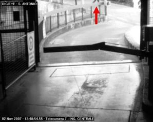 THIS PHOTO IS FROM THE PARKING GARAGE CCTV CAM SHOWING AN OFFICER ENTERING THE CRIME SCENE DRIVEWAY AT APPROXIMATELY 1 PM, WHICH WAS 10 MINUTES AFTER RAFFAELE CALLED THE POLICE