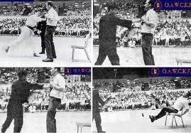 """The power behind Bruce Lee's one inch punch was """"chi"""" power which dramatically increased the power and force of his punches and kicks. Pictured here a demonstration of the sheer power and force of his once inch punch. sends a guy flying across the room."""