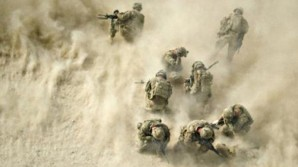 """American soldiers get """"dusted"""" as they await helicopter evacuation in Kandahar, Afghanistan."""