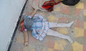 The headless corpse of a young Syrian girl lays in a courtyard of a school. She was killed by U.S. backed FSA rebels.