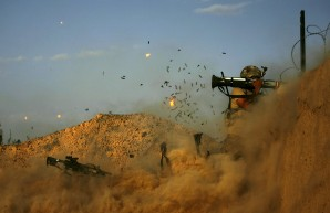 Lone infantryman with the 101st Airborne Division Alpha Battery 1-320th fires an AT-4 as Combat Outpost Nolen, Afghanistan during firefight.