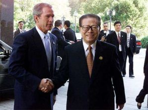 Bush shakes hand with Jiang Zemin in 2001 at the same time he was trying to blackmail China using the specter of a nuclear armed Japan.