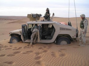 US troops bogged down in the sand in Afghanistan.