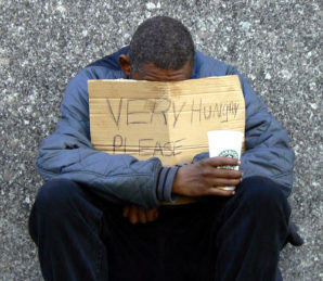 Feeling shame! Homeless man begs for food on the streets of America.
