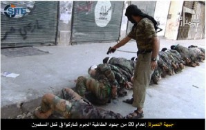 US backed terrorist affilated with the Free Syrian Army executes bound prisoners in that country - McCain says nothing?