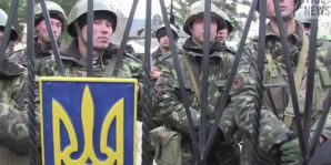 Ukrainian troops guard the gate of their military base in Crimea, while being surrounded by thousands of heavily armed Russian troops and special forces.