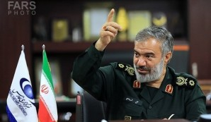 Commander of the Islamic Revolution Guards Corps Navy Rear Admiral Ali Fadavi underlined the IRGC's full preparedness to defend Iran's interests in the strategic Strait of Hormuz and the Persian Gulf, and warned that firing even one bullet at the country will burn the entire world. Picture courtesy of Fars news service in Iran.