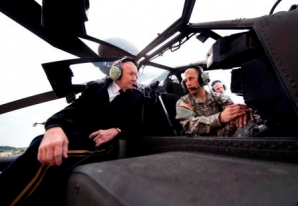 General Dempsey talks with Apache helicopter pilot at Ft. Riley, Kansas in 2012.