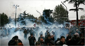 Georgian police let loose with CS tear gas on protesters before they go in an beat the smack out of resisters.