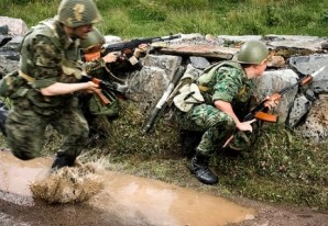 Russian marines scramble to take positions near hostile enemy force during military exercise in 2013.
