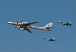 Russian TU-95 long rang strategic bomber with Mig 29 fighter escorts.