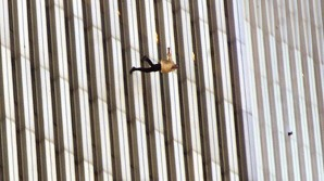 """""""9-11 was clearly an intelligence failure at the tactical level, since the intelligence agencies were unable to tell us when, where, how or who was going to attack us. In short they provided me with no actionable intelligence, nothing to utilize to preempt the attack"""", said Clarke. Pictured here a desperate man flings himself out of the towers on 9-11-2001  rather than burn to death in the incredible heat."""