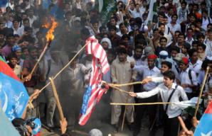 Pakistani protesters burn the American flag after the raid that killed Osama Bin Landin.
