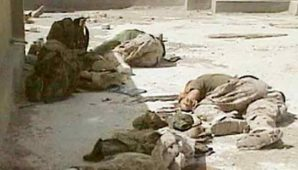 """Yesterday I listened with dismay when the Republican leader suggested and claimed that President Obama prematurely withdrew troops from Iraq. Think about that for a minute--5,500 dead Americans, tens of thousands wounded. Thousands and thousands have been wounded grievously"", said an exasperated Harry Reid. Pictured here: Dead marines in Fallujah, Iraq"