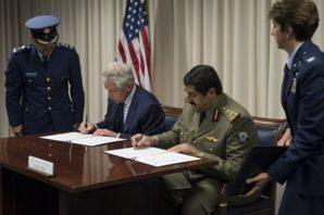 U.S. Defense Secretary Chuck Hagel and Hamad bin Ali al Attiyah,Qatari minister of state for defense affairs, sign a defense agreement at the Pentagon, July 14, 2014.  DoD photo by U.S. Navy Petty Officer 2nd Class Sean Hurt