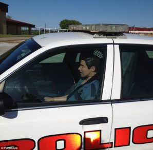 Cash strapped police departments using dummies dressed as cop to deter crime.