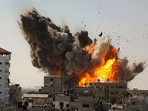 A building blows up in Libya during heavy bombardment by US warplanes in heavily populated civilian area.