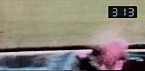 The infamous head shot on the Zapruder film, showing JFK brain exploding from the impact of the bullet shot by Oswald in the Texas repository building.