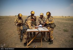 Iranian Army commanders plot positions along the border of Iran/ Iraq in preparation for a massive and crushing response if attacked by ISIS terrorists.