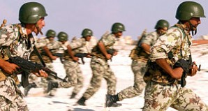 Egyptian army soldiers advance on a target during a military readiness exercise.