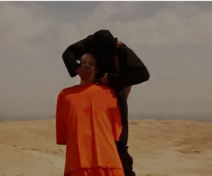 A US backed ISIS fighter begins to cut and hack the head of American Journaist Foley.