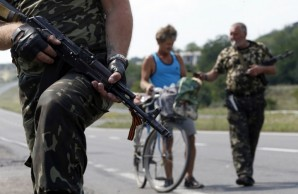 Pro Russian independence fighters in Ukraine man a military checkpoint in Donetsk.