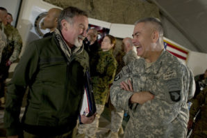 Comedian Robin Williams visits with Commanding General of Combined Task Force 101 U.S. Army Lt. Gen. John F. Campbell after the USO Holiday Tour show at Bagram Air Field, Afghanistan, on Dec.15, 2010. Chairman of the Joint Chiefs of Staff Adm. Mike Mullen, U.S. Navy, and his wife Deborah are hosting the holiday tour featuring Williams and comedians Lewis Black and Kathleen Madigan, Tour de France champion Lance Armstrong and country musicians Kix Brooks and Bob Dipiero touring the Central Command area of responsibility. DoD photo by Petty Officer 1st Class Chad J. McNeeley, U.S. Navy.