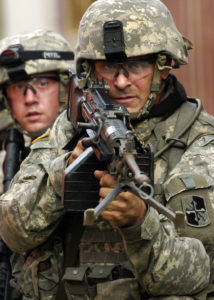 Soldiers from the U.S. Army's Charlie and Delta Company, 1st Battalion, 175th Infantry Regiment, Maryland Army National Guard, combine efforts during a joint urban cordon and search exercise in the mock city of Balad at Fort Dix, N.J. Staff Sgt. Russell Lee Klika, U.S. Army.  (Released)