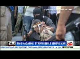 Syrian rebel behead captured soldier.