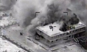 This still image made from video released by the U.S. Central Command on Tuesday, Sept. 23, 2014, shows a structure in Tall Al Qitar, Syria moments after a U.S. airstrike. In three waves of nighttime attacks launched over four hours early on Tuesday, the U.S. and its Arab partners made more than 200 airstrikes against roughly a dozen militant targets in Syria. (US Central Command)