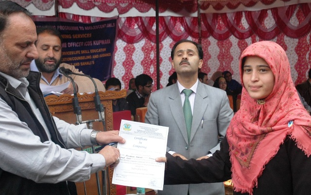 DC Kupwara,Director  ICDS distributing scholarship