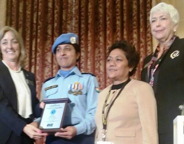 Inspector Shakti Devi receiving International Peacekeeper awards