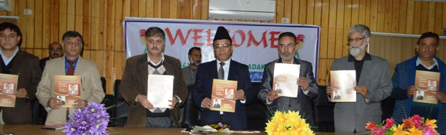 Minister Releasing Souvenir on path breaking initiatives of six budgets