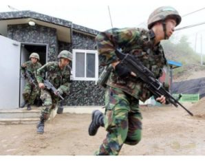 South Korean Army soldiers scramble during alert on Sunday as shots were exchanged along the DMZ.
