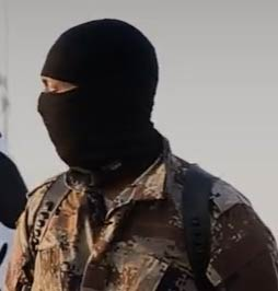 A suspected US fighter with ISIS in video on Youtube taunts prisoners forced to dig their own graves.