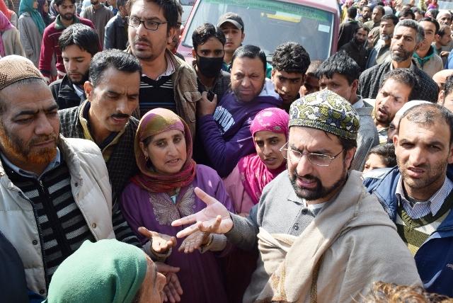 APHC leader, Mirwaiz Umar Farooq with flood victims