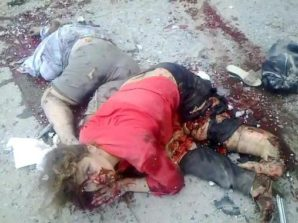 A woman is literally blown apart by a artillery shell in Lugansk, fired by the Ukrainian Army (2014) into a civilian enclave near the Russian border with Ukraine. She died a short time later...