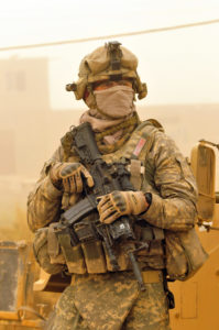 A U.S. Army soldier with 1st Squadron, 150th Cavalry Regiment, 30th Heavy Brigade Combat Team, 1st Cavalry Division wears a mask to protect himself from a dust storm in Baghdad, Iraq, on June 27, 2009.  DoD photo by Petty Officer 2nd Class Edwin L. Wriston, U.S. Navy.  (Released)