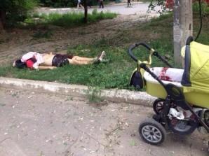 Woman has been heavily injured during bombing of Lugansk, Child survived. Blood on stroller #Ukraine  12:17 PM - 14 Jul 2014. Credit: Twitter  Nicolaj Gericke
